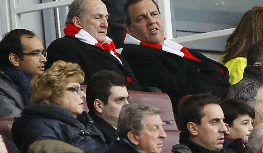 Governor of New Jersey Chris Christie, top right, wearing an Arsenal scarf in the stands during  the English Premier League soccer match between Arsenal and Aston Villa at the Emirates stadium in London, Sunday, Feb. 1, 2015.  In the front centre  the England international coach Roy Hodgson sits with former England international player Gary Neville. (AP Photo/Kirsty Wigglesworth)