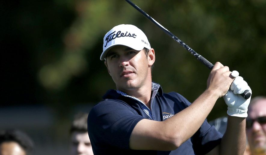 Brooks Koepka tees off on the fifth hole during the final round of the Phoenix Open golf tournament, Sunday, Feb. 1, 2015, in Scottsdale, Ariz. (AP Photo/Rick Scuteri)