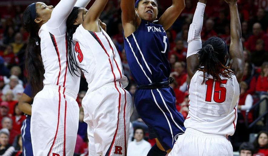 Penn State guard Sierra Moore (5) takes a shot while being triple teamed by Rutgers center Rachel Hollivay (l), guard Tyler Scaife (3) and guard Syessence Davis (15) during the first half of an NCAA college basketball game in Piscataway, N.J., Sunday, Feb. 1, 2015. (AP Photo/Rich Schultz)