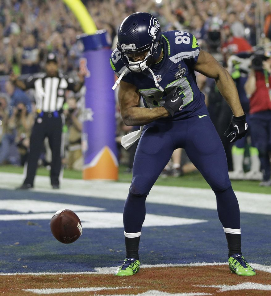 Seattle Seahawks wide receiver Doug Baldwin (89) celebrates a touchdown during the second half of NFL Super Bowl XLIX football game against the New England Patriots Sunday, Feb. 1, 2015, in Glendale, Ariz. (AP Photo/Mark Humphrey)
