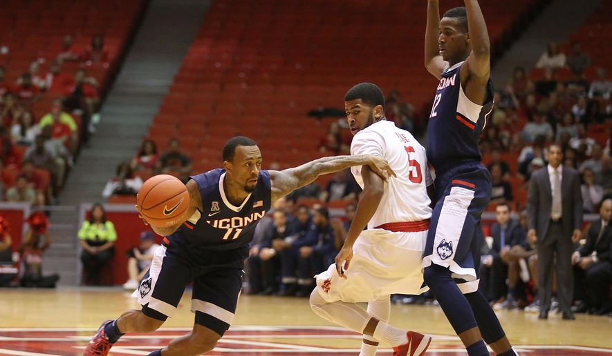 UConn guard Ryan Boatright (11) dribbles around Houston guard L.J. Rose (5) while UConn forward Kentan Facey (12) sets a pick in the first half in a NCAA basketball game on Sunday, Feb. 1, 201,5 at Hofheinz Pavilion in Houston.   (AP Photo/Houston Chronicle,  Thomas B. Shea)