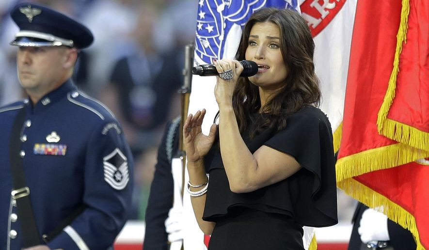 Idina Menzel sings the national anthem before the NFL Super Bowl XLIX football game between the Seattle Seahawks and the New England Patriots Sunday, Feb. 1, 2015, in Glendale, Ariz. (AP Photo/Michael Conroy)