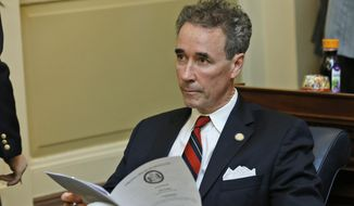 FILE - In a Wednesday, Jan. 21, 2015 file photo, Del. Joe Morrissey, I-Henrico, looks over the calendar during the House session at the Capitol in Richmond, Va.  Nearly three weeks after the 2015 legislative session started, leaders in the Virginia House of Delegates are still trying to figure out what to do with Morrissey, who is spending nights in jail after a sex scandal involving a teenager. Morrissey resigned his House of Delegates seat after prosecutors accused him of having sex with a 17-year-old girl. While serving a six-month jail term for contributing to the delinquency of a minor, he ran as an independent in a special election and reclaimed his seat. (AP Photo/Steve Helber, File)