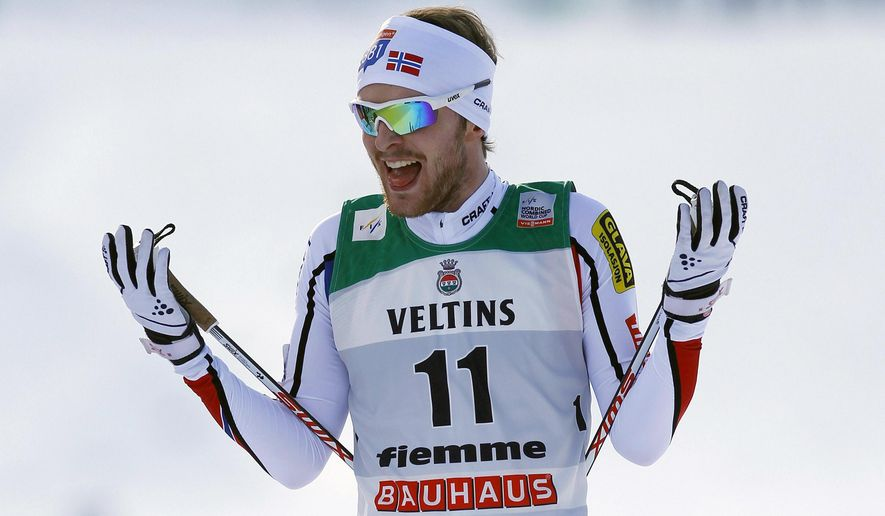 Joergen Graabak, of Norway, celebrates in the finish area after winning a Nordic Combined World Cup competition in Val di Fiemme, northern Italy, Sunday, Feb. 1, 2015. (AP Photo/Andrea Solero, Ansa) ITALY OUT