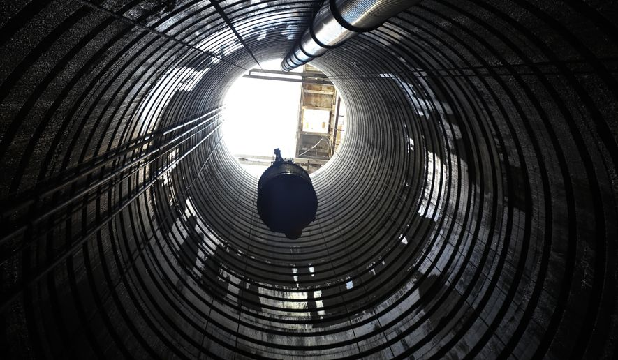 In this Friday, Jan. 9, 2015 photo, a large bucket loaded with rock is lifted out of Shaft 6B in Wappinger, N.Y. Crews starting a project to fix a section of the Delaware Aqueduct that provides New York City with about half its drinking water are busy blasting and drilling hundreds of feet below ground. (AP Photo/Mike Groll)
