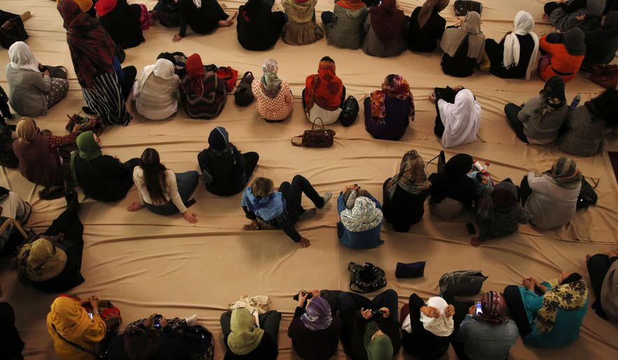 Women prepare for the Women's Mosque of America's first monthly Friday prayer, called jumma'a, at the Pico Union Project in downtown Los Angeles, Friday, Jan. 30, 2015. (AP Photo/Los Angeles Times, Katie Falkenberg)
