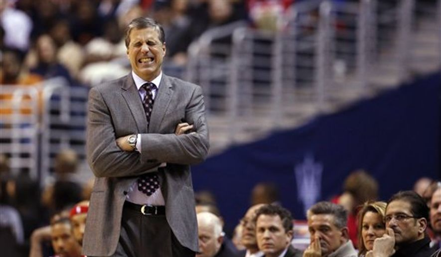 Washington Wizards coach Randy Wittman reacts to a play in the second half of an NBA basketball game against the Toronto Raptors, Saturday, Jan. 31, 2015, in Washington. The Raptors won 120-116 in overtime. (AP Photo/Alex Brandon)