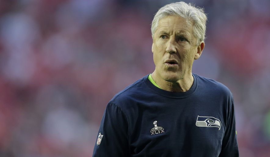 Seattle Seahawks head coach Pete Carroll walks on the field before the NFL Super Bowl XLIX football game against the New England Patriots on Sunday, Feb. 1, 2015, in Glendale, Ariz. (AP Photo/Matt Rourke)