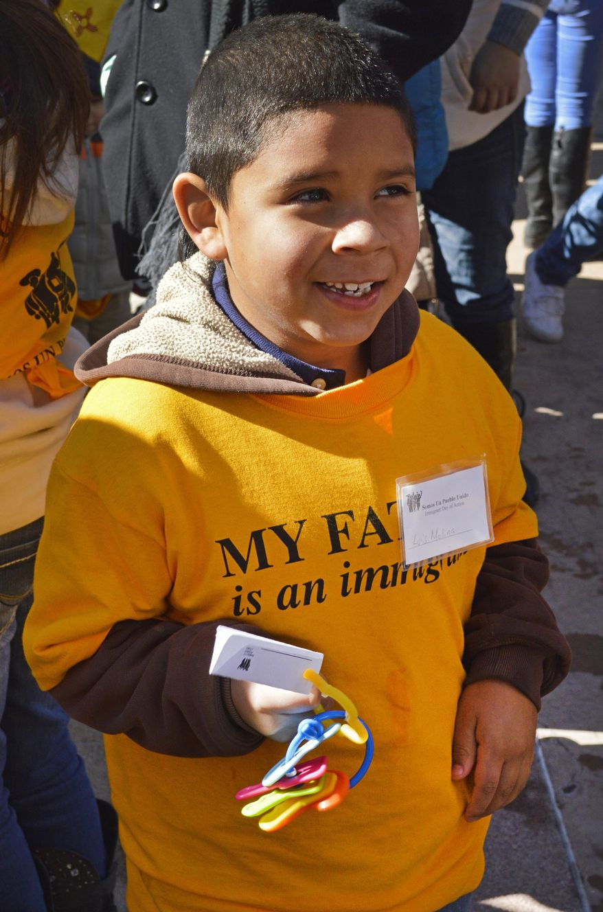 Luis Molina, 6, of Clovis, N.M., holds a set of protest keys during a rally at the State Capitol to protest a proposal aimed at repealing a New Mexico law that allows immigrants in the country illegally to obtain driver's licenses Monday, Feb. 2, 2015, in Santa Fe, N.M. (AP Photo/Russell Contreras)