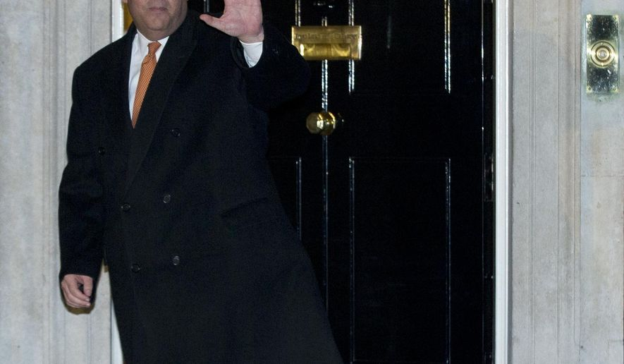 New Jersey Gov. Chris Christie waves to the media as he leaves 10 Downing Street following a meeting with Britain's Prime Minister David Cameron, in London Monday, Feb. 2, 2015. (AP Photo/Alastair Grant)