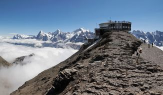"A view toward Schilthorn from the direction of its west ridge in the anton of Bern, Switzerland. ""Switzerland's most spectacular view is at the Schilthorn,"" Urs Hauser promised, and he should know. The goateed hotelier's roots stretch back 1,000 years in Grindelwald, a launching pad to the Jungfrau and other Bernese Alps peaks, where his family opened Hotel Belvedere in 1907. (Simo Rasanen)"