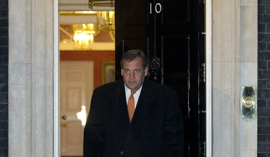 New Jersey Gov. Chris Christie looks towards the media leaves 10 Downing Street following a meeting with Britain's Prime Minister David Cameron, in London Monday, Feb. 2, 2015. (AP Photo/Alastair Grant)