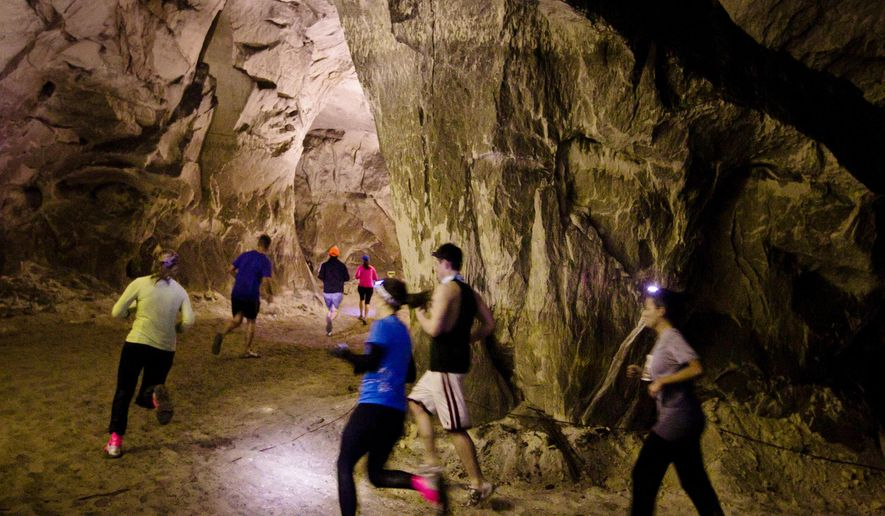 FILE -- In this Feb. 12, 2012 file photo, runners round the caves during the Sand Mine Challenge at the Crystal City Underground in Crystal City, Mo. Tom Kerr purchased the cave several years ago with plans to use it for conventions, office space, concerts and recreational sports, but county officials contend otherwise, calling Crystal City Underground a nuisance that violates public safety and poses a threat to public health. (AP Photo/St. Louis Post-Dispatch, Erik M. Lunsford, File) EDWARDSVILLE INTELLIGENCER OUT; THE ALTON TELEGRAPH OUT