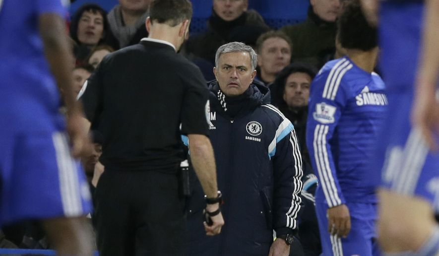 Chelsea Manager Jose Mourinho looks across the pitch towards referee Mark Clattenburg during the English Premier League soccer match between Chelsea and Manchester City at Stamford Bridge, London, England, Saturday, Jan. 31, 2015. (AP Photo/Tim Ireland)
