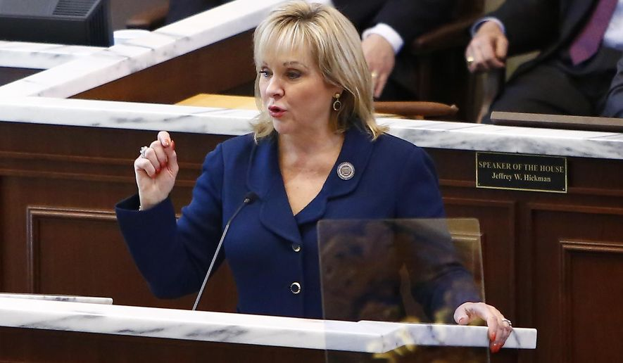 Oklahoma Gov. Mary Fallin gestures as she speaks to legislators during the State of the State address in Oklahoma City, Monday, Feb. 2, 2015. (AP Photo/Alonzo Adams)