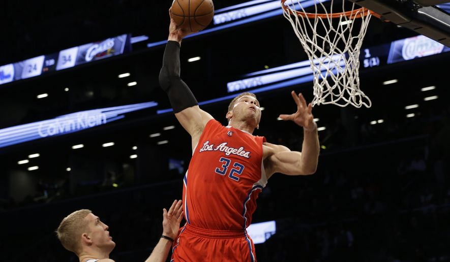 Los Angeles Clippers forward Blake Griffin (32) goes up to the net past Brooklyn Nets center Mason Plumlee during the first half of NBA basketball game, Monday, Feb. 2, 2015, in New York.  (AP Photo/Mary Altaffer)