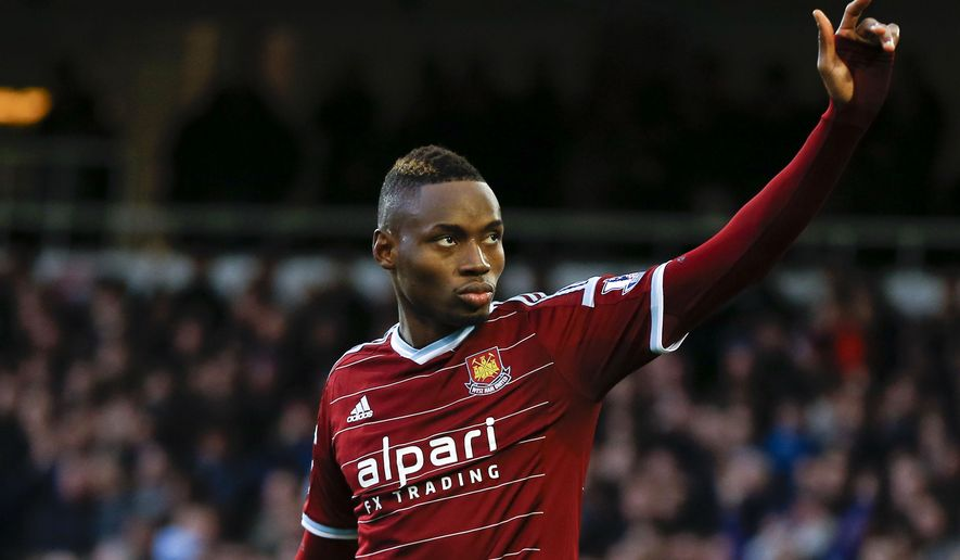 FILE - In this Sunday, Dec. 7, 2014 file photo, West Ham's Diafra Sakho celebrates scoring a goal during the English Premier League soccer match between West Ham and Swansea at White Hart Lane stadium in London. Senegal international Diafra Sakho and his English club, West Ham, face possible punishment from FIFA for a potential violation of regulations relating to the striker's availability for the African Cup of Nations. Sakho withdrew from Senegal's squad before the tournament began on Jan. 17, 2015, citing a back injury, but played for West Ham in its FA Cup fourth-round match against Bristol City on Jan. 25. He came off the bench to score the winner in a 1-0 victory. World football's governing body announced Monday, Feb. 2, 2015 it has opened a disciplinary case. (AP Photo/Kirsty Wigglesworth, file)