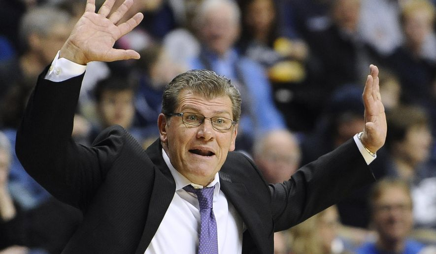 FILE - In this Jan. 18, 2015, file photo, UConn women's basketball head coach Geno Auriemma reacts during the second half of an NCAA college basketball game against South Florida in Storrs, Conn. Auriemma can record his 900th career win on Tuesday when his second-ranked Huskies host Cincinnati. (AP Photo/Jessica Hill, File)