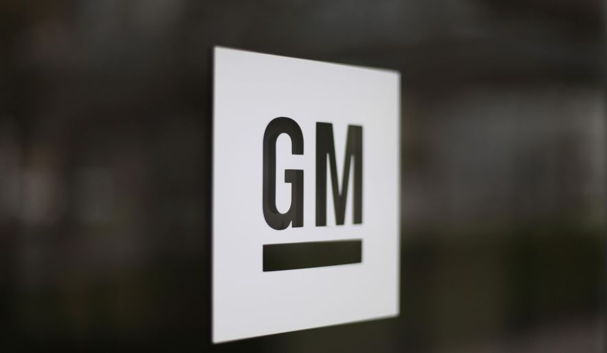 FILE - This Friday, May 16 2014, file photo, shows the General Motors logo at the company's world headquarters in Detroit. More than 1,100 claims were filed in the week before the Saturday, Jan. 31, 2015, deadline to seek payments from the General Motors ignition switch compensation fund, with 51 death and 77 injury claims being granted. (AP Photo/Paul Sancya, File)