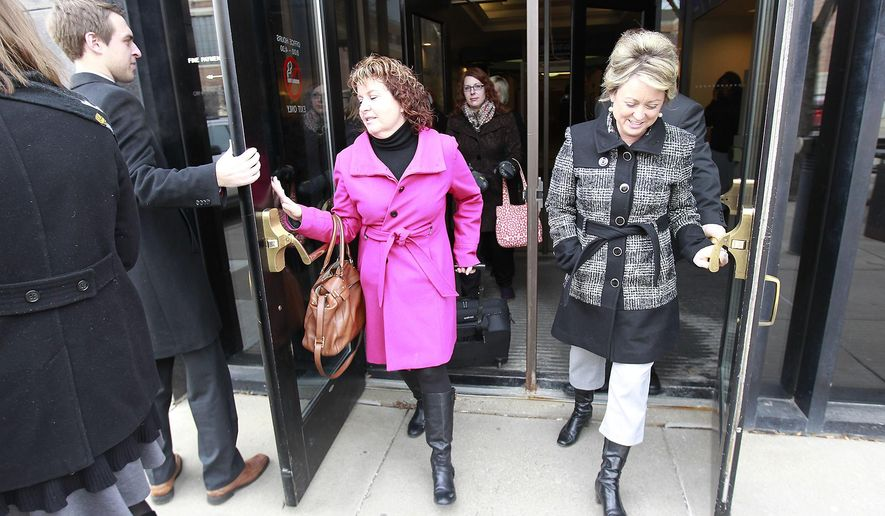 Defense attorney Lauri Traub, left, and her team left the courthouse after closing arguments at the St. Cloud courthouse, Monday, Feb. 2, 2015 in St. Cloud, Minn. (AP Photo/The Star Tribune, Elizabeth Flores)