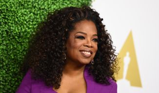 Oprah Winfrey arrives at the 87th Academy Awards nominees luncheon at the Beverly Hilton Hotel on Monday, Feb. 2, 2015, in Beverly Hills, Calif. (Photo by Jordan Strauss/Invision/AP) ** FILE **