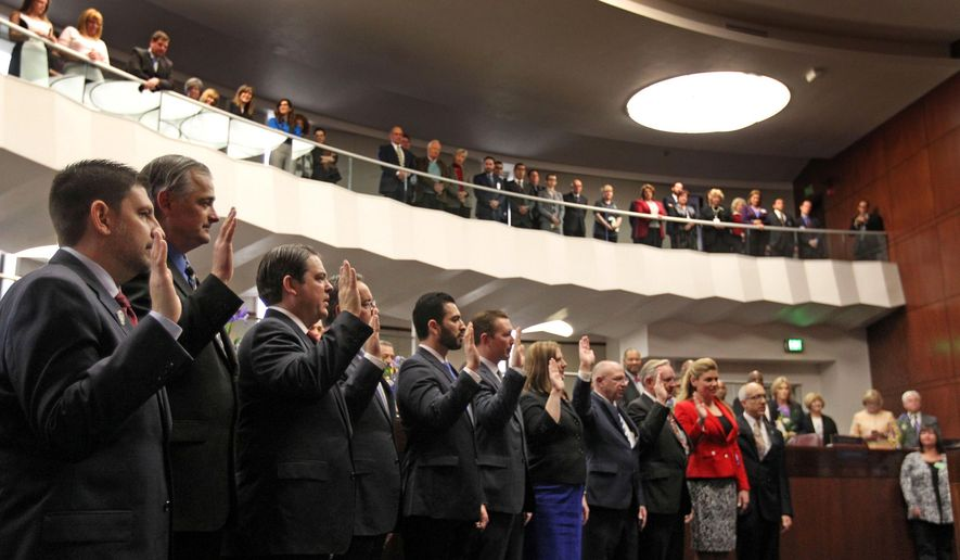 Recently reelected Nevada Senators take the oath of office during the opening session of the Nevada Legislature in Carson City, Nev., Monday, Feb. 2, 2015. (AP Photo/Lance Iversen)