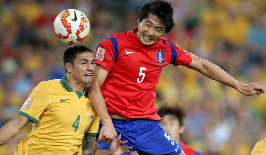 South Korea's Kwak Tae-hwi, right, and Australia's Tim Cahill battle for the ball during the AFC Asian Cup final soccer match between South Korea and Australia in Sydney, Australia, Saturday, Jan. 31, 2015. (AP Photo/Rick Rycroft)