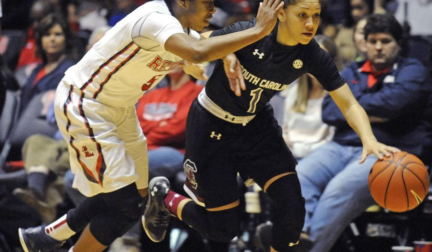 South Carolina guard Bianca Cuevas (1) drives past Mississippi guard Erika Sisk (5) during the second half of an NCAA college basketball game, Sunday, Feb. 1, 2015, in Oxford, Miss. South Carolina won 77-59. (AP Photo/Thomas Graning)