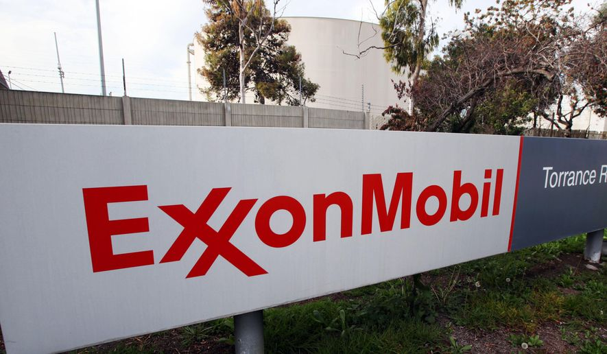The sign for the ExxonMobil Torerance Refinery in Torrance, Calif., is seen here on Jan. 30, 2012. (Associated Press) **FILE**