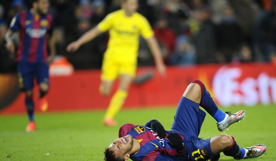 FC Barcelona's Neymar, from Brazil, reacts on the ground during the match against Villarreal during a Spanish La Liga soccer match at the Camp Nou stadium in Barcelona, Spain, Sunday, Feb. 1, 2015. (AP Photo/Manu Fernandez)