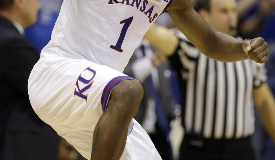 Kansas guard Wayne Selden Jr. (1) celebrates a 3-point basket during the second half of an NCAA college basketball game against Iowa State in Lawrence, Kan., Monday, Feb. 2, 2015. Selden scored 20 points in the game. Kansas defeated Iowa State 89-76. (AP Photo/Orlin Wagner)