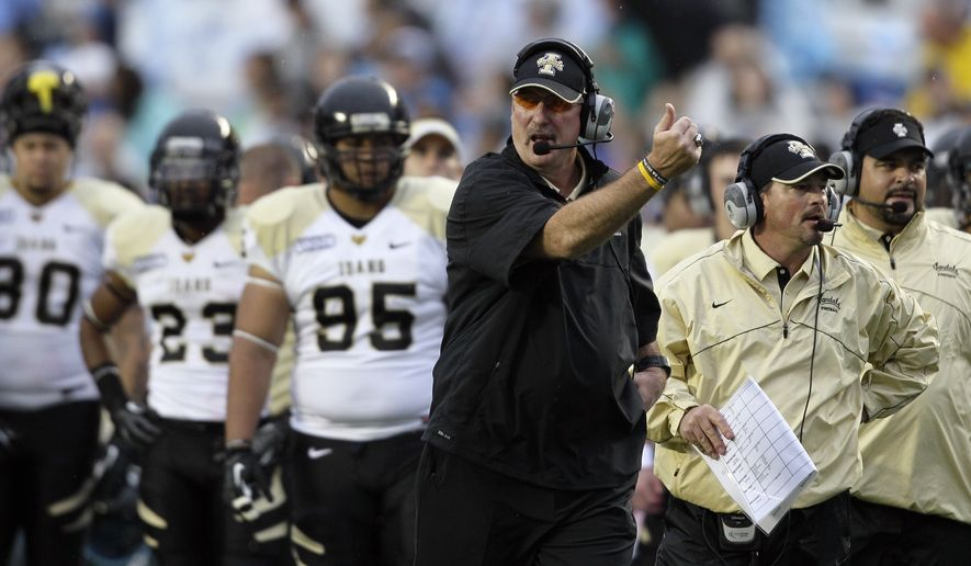 Idaho coach Robb Akey coaches his players during the first half of an NCAA college football game in Chapel Hill, N.C., Saturday, Sept. 29, 2012. (AP Photo/Gerry Broome)