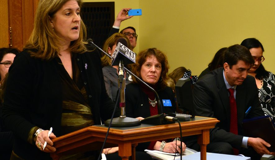"Julie Burkhart, chief executive of the Trust Women Foundation abortion-rights group, spoke against a Kansas bill that would ban an abortion procedure, saying it would harm women. Pro-life groups wish to ban ""dismemberment"" abortions. (AP Photo/Nicholas Clayton)"