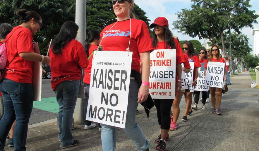 Kaiser Permanente employees picket Kaiser's Honolulu clinic on Monday, Feb. 2, 2015. The workers, members of the Unite Here Local 5 union, started a six-day strike on Monday in objection to what the union calls a low proposed wage increase and a proposal to eliminate guaranteed pensions for new employees. (AP Photo/Audrey McAvoy)