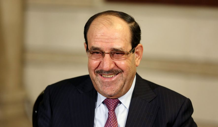 Iraq's Vice President and former Prime Minister Nouri al-Maliki, smiles during an interview with The Associated Press in Baghdad, Iraq, Monday, Feb. 2, 2015. Al-Maliki denies he is seeking a political comeback despite frequent appearances in local media and a recent high-profile visit to influential neighboring Iran. (AP Photo/Khalid Mohammed)