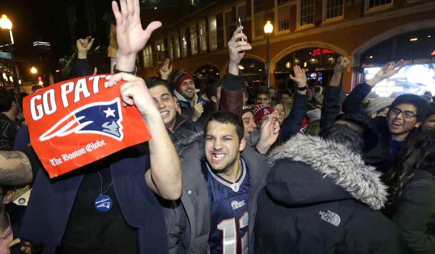 New England Patriots fans celebrate Sunday, Feb. 1, 2015, in Boston, after the Patriots won the NFL Super Bowl XLIX football game against the Seattle Seahawks 28-24 in Glendale, Ariz.(AP Photo/Steven Senne)