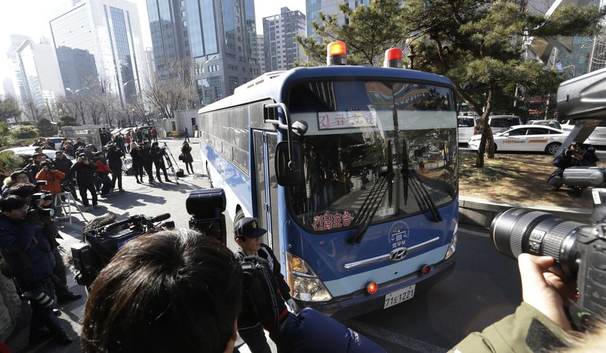 A bus carrying Cho Hyun-ah, former vice president of Korean Air Lines Co., arrives for her trial at the Seoul Western District Court in Seoul, South Korea, Monday, Feb. 2, 2015. Cho on trial after an inflight tantrum over a serving of nuts defended her actions as the result of devotion to work in the final day of testimony. (AP Photo/Ahn Young-joon)