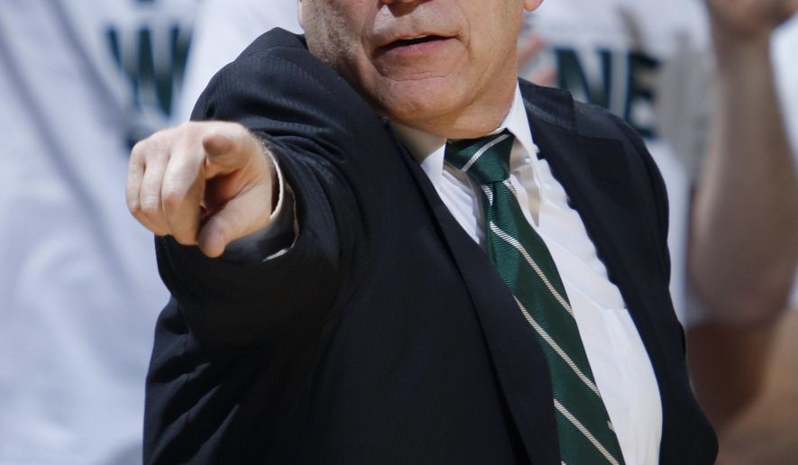 Michigan State coach Tom Izzo gives instructions during the second half of an NCAA college basketball game against Michigan, Sunday, Feb. 1, 2015, in East Lansing, Mich. Michigan State won 76-66 in overtime. (AP Photo/Al Goldis)