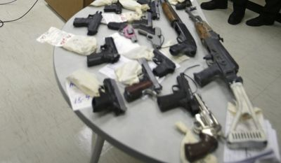 Cuyahoga County Prosecutor Timothy J. McGinty answers questions during a news conference, Monday, Feb. 2, 2015 in front of a table full of guns taken from gang members in Cleveland. (AP Photo/Tony Dejak) ** FILE **