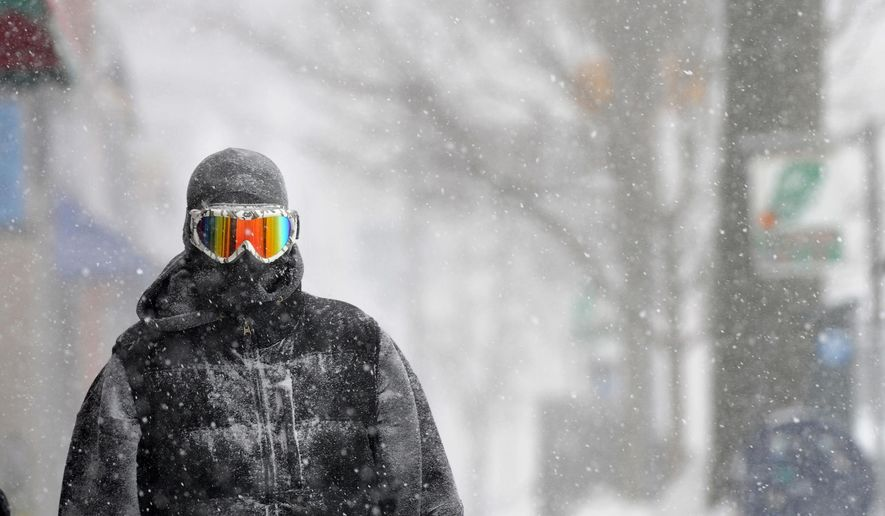 Guy Cournoyer of Northampton adds some color to an otherwise white-out day in downtown Northampton, Mass., Monday, Feb. 2, 2015. Cournoyer says the combination of ski goggles and a full head-covering balaclava leaves no exposed skin. (AP Photo/The Daily Hampshire Gazette, Kevin Gutting)
