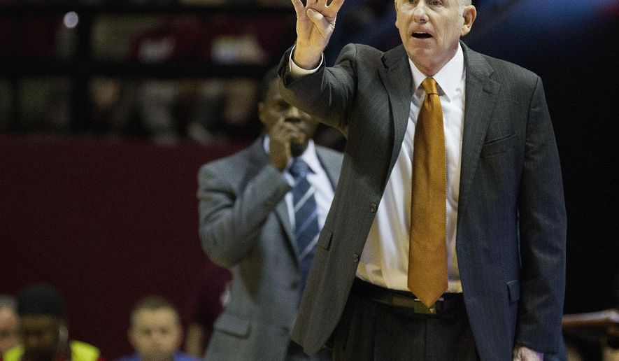 Miami head coach Jim Larranaga signals to his team in the first half of an NCAA college basketball game against Florida State, Sunday, Feb. 1, 2015, Tallahassee, Fla.  Florida State won 55-54. (AP Photo/Mark Wallheiser)