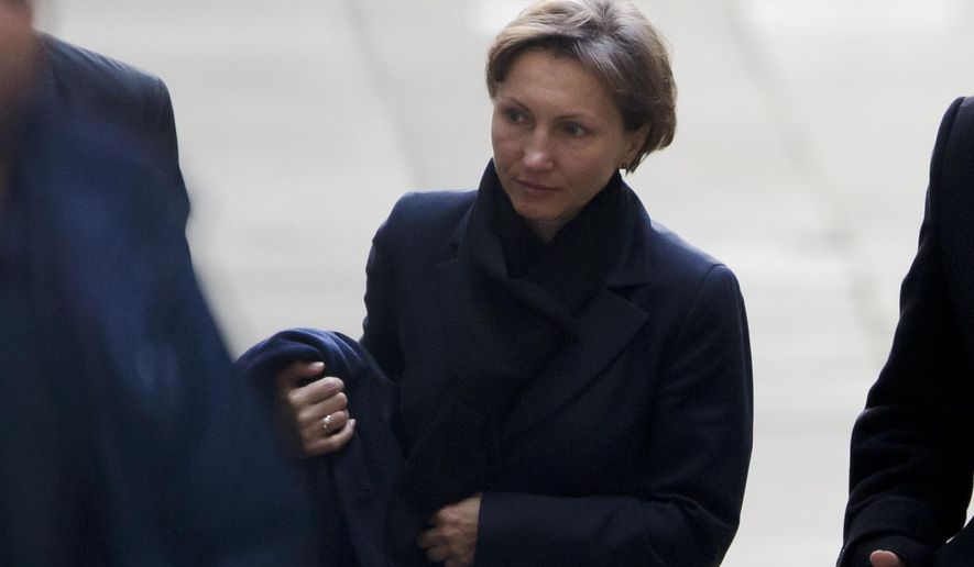 """Marina Litvinenko, the widow of former Russian intelligence officer Alexander Litvinenko, arrives on the day she is due to give evidence at the inquiry into her husband's death at the Royal Courts of Justice in London, Monday, Feb. 2, 2015.  The body of former Russian agent Alexander Litvinenko was so radioactive that his post-mortem was """"one of the most dangerous"""" ever undertaken and the isotope that killed him so rare it would not have been discovered by a normal autopsy, a pathologist said Wednesday.  (AP Photo/Matt Dunham)"""