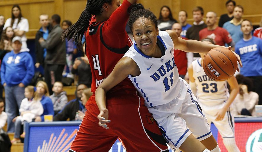 Duke's Azura Stevens, right, drives to the basket against Louisville's Mariya Moore during the first half of an NCAA college basketball game Monday, Feb. 2, 2015, in Durham, N.C. (AP Photo/Ellen Ozier)