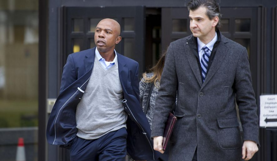 Basketball analyst Greg Anthony, 47, left, leaves the D.C. Superior Court with his attorney Danny Onorato after being arraigned in Washington, Monday, Feb. 2, 2015. Anthony is charged with soliciting a prostitute at a Washington hotel on Jan. 16 after court documents say he responded to an escort ad authorities placed on the classifieds website Backpage.com. (AP Photo/Cliff Owen)