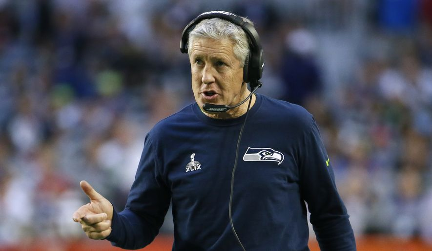 Seattle Seahawks head coach Pete Carroll walks the sidelines during the first half of NFL Super Bowl XLIX football game against the New England Patriots Sunday, Feb. 1, 2015, in Glendale, Ariz. (AP Photo/Matt York)