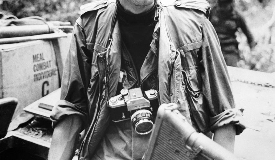 This is a December 1967, image taken in Vietnam of veteran newsman Al Webb, made available by Corbis on Tuesday Feb 3, 2015. Al Webb has died in England after a long career in which he received a military medal for valor while covering the war in Vietnam. He was 79. His wife Elizabeth Webb said Tuesday Feb. 3, 2015 that he died Jan. 25 at a hospital in Banbury, 75 miles (120 kilometers) northwest of London from complications from pneumonia and diabetes. (AP Photo/CORBIS) NO ACHIVE