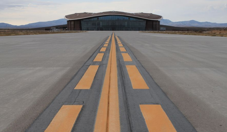 This Dec. 9, 2014, image shows the taxiway leading to the hangar at Spaceport America in Upham, N.M. Spaceport officials are planning to open a visitors' gallery at the hangar in late February and are looking forward to SpaceX beginning test flights for its rocket program this spring. (AP Photo/Susan Montoya Bryan)