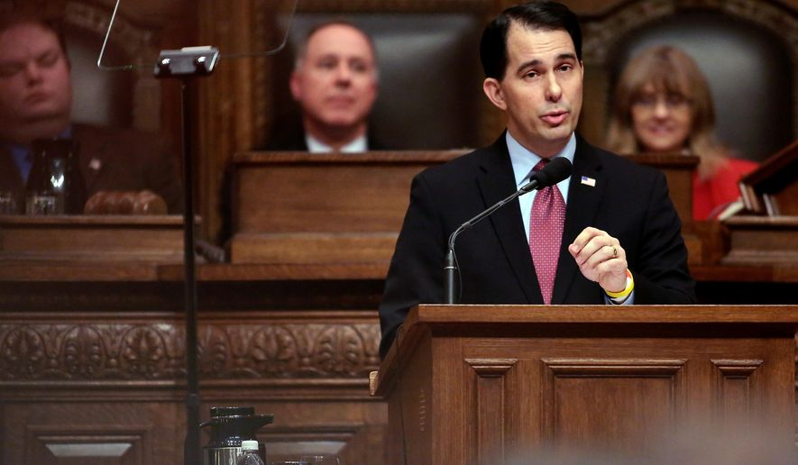 Wisconsin Governor Scott Walker delivers his state budget address at the Wisconsin state Capitol in Madison, Wis. Tuesday, Feb. 3, 2015. (AP Photo/Wisconsin State Journal, John Hart)