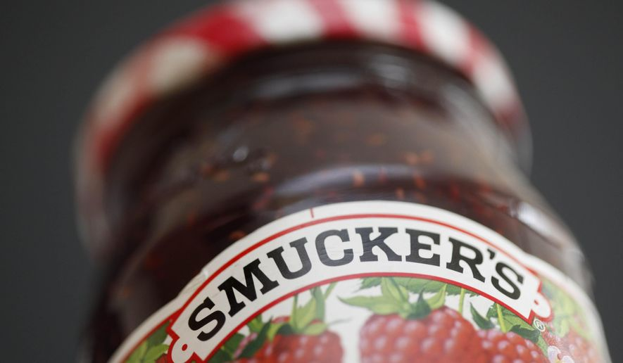 FILE - In this Aug. 16, 2010, file photo, a jar of Smucker's preserves is displayed in Philadelphia. J. M. Smucker Co. is buying Meow Mix maker Big Heart Pet Brands in a $3.2 billion cash-and-stock deal, giving it a presence in the fast-growing pet food industry.(AP Photo/Matt Rourke, File)