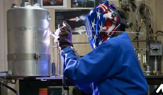 Image of a patriotic American worker from the National Association of Manufacturers